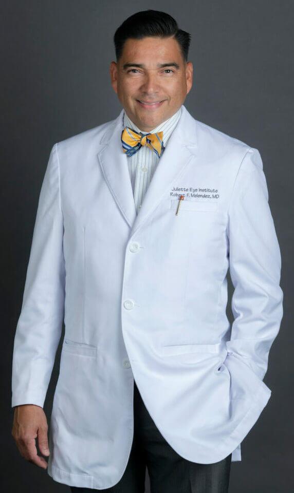 Dr. Melendez in white coat