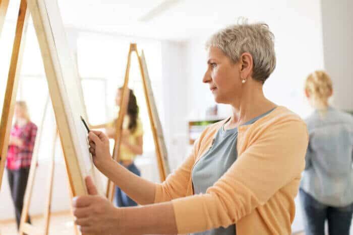 Woman at art easel